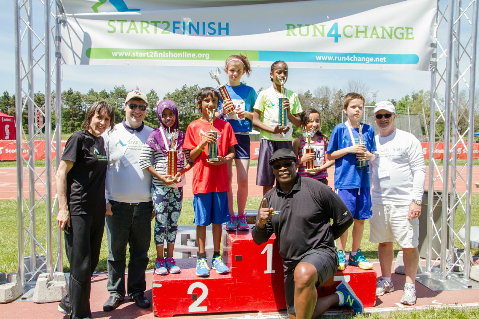 Coached by a children's author Fati (on the 1st place podium) wrote a book and won the 5k race